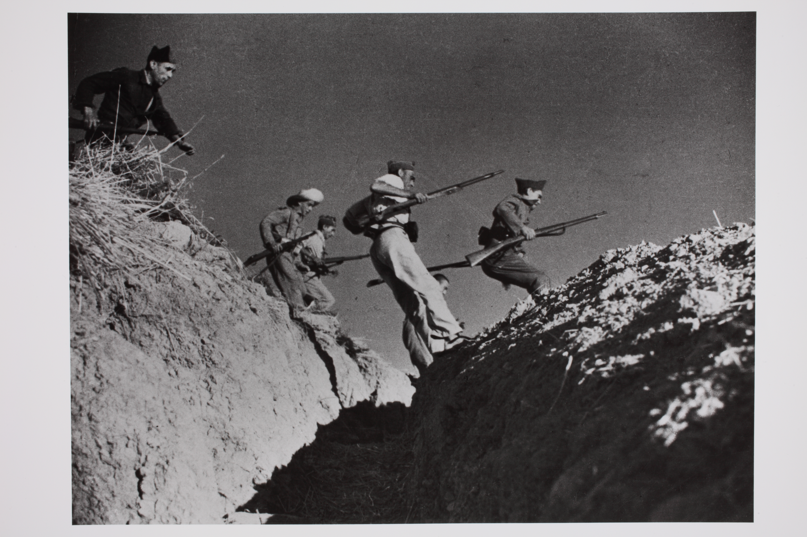 Loyalist militiamen jumping over a gully, Córdoba front, Spain © Robert Capa © International Center of Photography/Magnum Photos