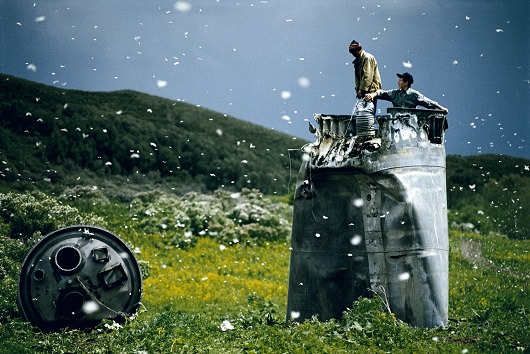 RUSSIA. Altai Territory. 2000. Villagers collecting scrap from a crashed spacecraft, surrounded by thousands of white butterflies. Environmentalists fear for the region's future due to the toxic rocket fuel.