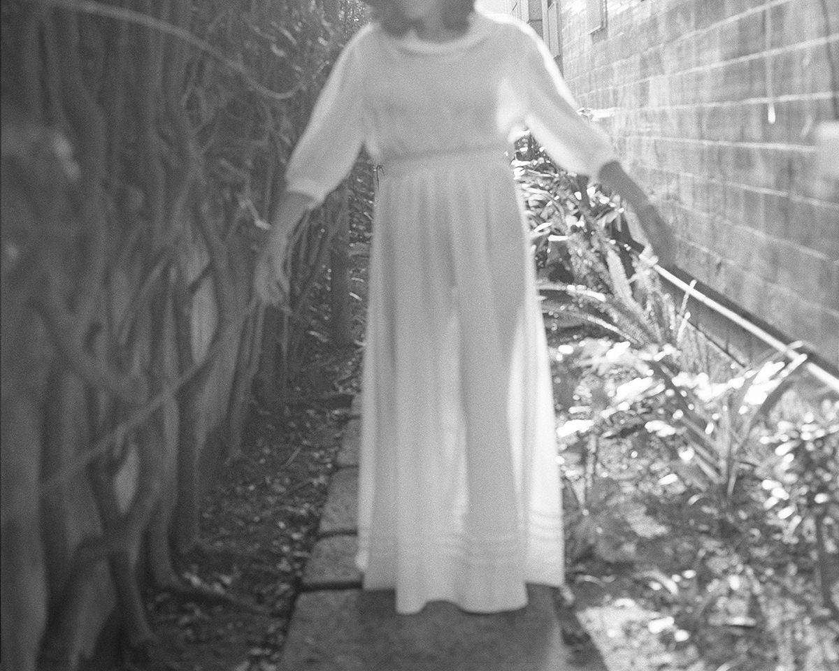 Ines Marinho: Mom wearing her wedding dress at her childhood house garden, 2019 © Ines Marinho